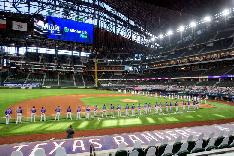 FILE – The Texas Rangers and Colorado Rockies line the foul lines of Globe Life Field before an opening day baseball game in Arlingtn, Texas, in this Friday, July 24, 2020, file photo. The Texas Rangers could have a full house for their home opener next month after debuting their new 40,518-seat stadium without fans in the stands for their games last season. If that happens, the Rangers could be the first team in MLB or any U.S.-based sport to have a full-capacity crowd since the coronavirus pandemic started rapidly shutting down sports a year ago this week. (AP Photo/Jeffrey McWhorter, File)