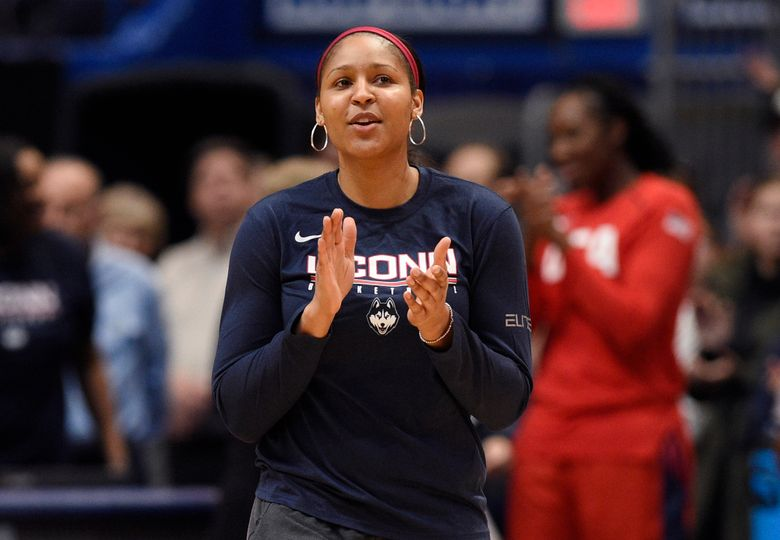 FILE – In this Jan. 27, 2020, file photo, former Connecticut and Minnesota Lynx player Maya Moore applauds in Hartford, Conn. Moore says she is not ready to return to the WNBA. The basketball star said on ABC's Good Morning America that she remains focused for now on her marriage to Jonathan Irons and their activism for criminal justice reform. She has not played for the Minnesota Lynx since the 2018 season.  (AP Photo/Jessica Hill, File)