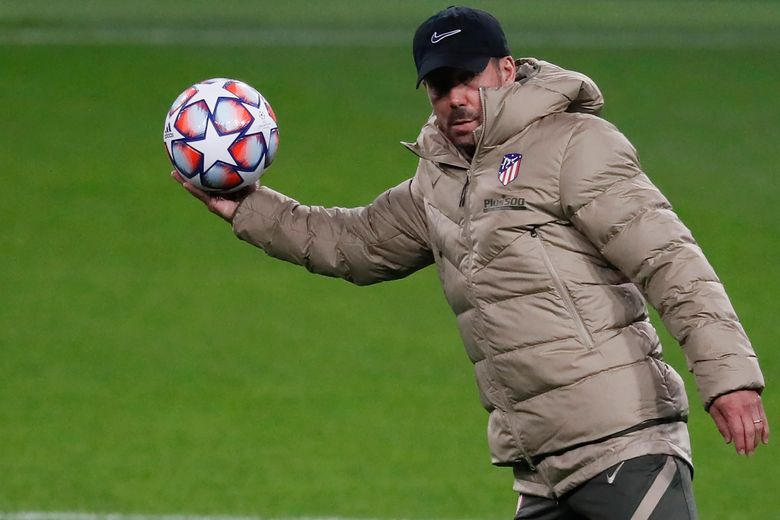 FILE – In this file photo dated Monday, Nov. 2, 2020, Atletico Madrid's head coach Diego Simeone attends a training session in Moscow, Russia.  Diego Simeone's Atletico Madrid will try to deal a severe blow to Real Madrid's title defense on upcoming Sunday March 7, 2021. (Yuri Kochetkov/Pool FILE via AP)