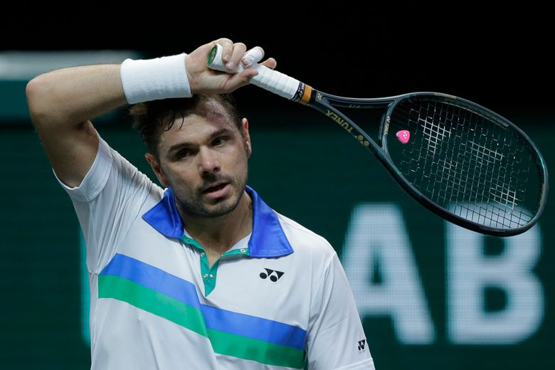 Switzerland's Stan Wawrinka wipes his forehead in his first round men's singles match of the ABN AMRO world tennis tournament against Russia's Karen Khachanov at Ahoy Arena in Rotterdam, Netherlands, Tuesday, March 2, 2021. (AP Photo/Peter Dejong)
