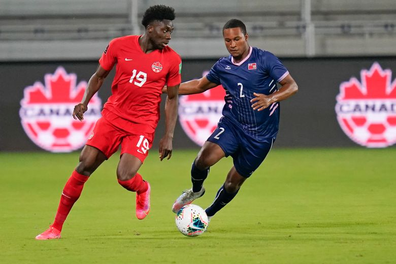 Canada forward Alphonso Davies (19) moves to get past Bermuda defender Eusebio Blankendal (2) during the first half of a World Cup 2022 Group B qualifying soccer match, Thursday, March 25, 2021, in Orlando, Fla. (AP Photo/John Raoux)