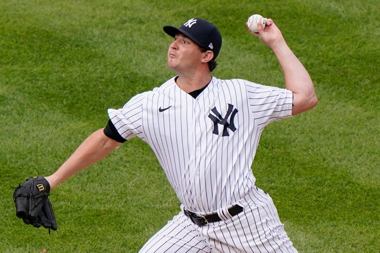 FILE – New York Yankees relief pitcher Zack Britton winds up during the eighth inning of a baseball game against the Baltimore Orioles in New York, in this Sunday, Sept. 13, 2020, file photo. Yankees left-hander Zack Britton is not throwing because of a sore pitching elbow, was to be examined by a doctor on Tuesday, March 9, 2021, and could miss the start of the season. (AP Photo/Kathy Willens, File)