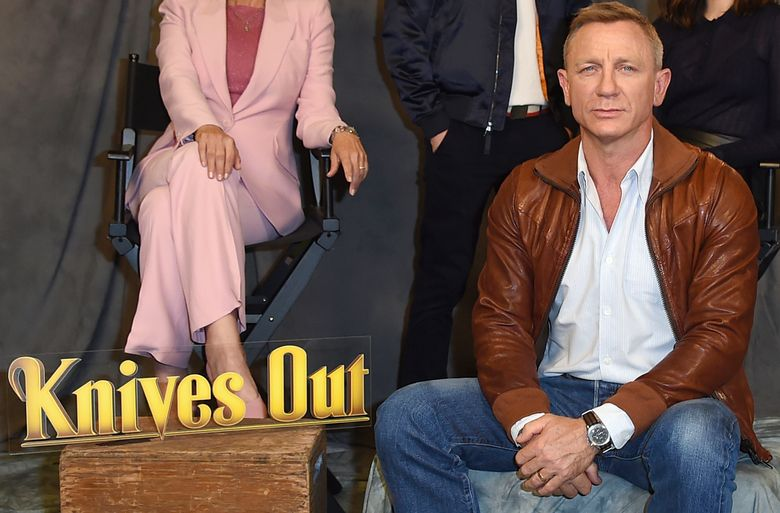 """FILE – Daniel Craig attends the """"Knives Out"""" photo call on Nov. 15, 2019, in Los Angeles. Netflix said Wednesday, March 31, 2021, it has reached a deal for two sequels to Rian Johnson's acclaimed 2019 whodunit, """"Knives Out."""" Johnson will direct with Daniel Craig returning as inspector Benoit Blanc. (Photo by Jordan Strauss/Invision/AP, File)"""