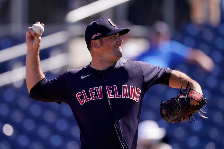 Cleveland Indians pitcher Adam Plutko throws during the first inning of a spring training baseball game against the Seattle Mariners Tuesday, March 2, 2021, in Peoria, Ariz. (AP Photo/Charlie Riedel)