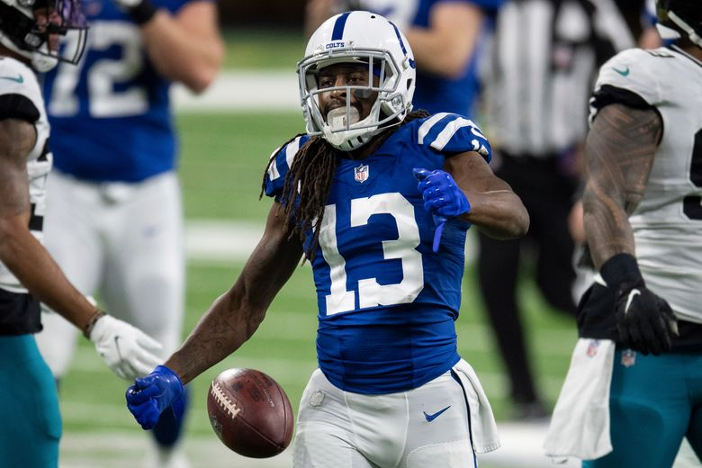 FILE – In this Jan. 3, 2021, file photo, Indianapolis Colts wide receiver T.Y. Hilton celebrates a catch during the team's NFL football game against the Jacksonville Jaguars in Indianapolis. Hilton tested the free-agent market and came to the same conclusion he made last summer — he wanted to stay in Indianapolis. So on Wednesday, March 24, the longtime Colts receiver agreed to a one-year contract worth $10 million and $8 million in guaranteed money. (AP Photo/Zach Bolinger, File)