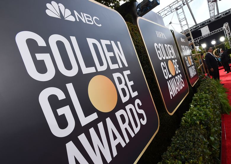 """FILE – Event signage appears above the red carpet at the 77th annual Golden Globe Awards, Sunday, Jan. 5, 2020, in Beverly Hills, Calif. More than 100 Hollywood publicity firms that collectively represent the majority of stars in film and television, said they will advise their clients to skip the Golden Globes if the Hollywood Foreign Press Association does not commit to """"transformational change.""""  (Photo by Jordan Strauss/Invision/AP, File)"""