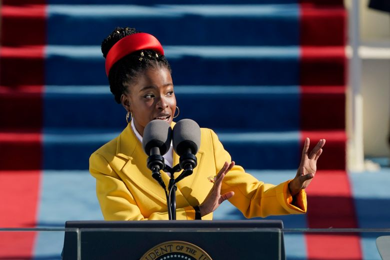 FILE – In this file photo dated Wednesday, Jan. 20, 2021, American poet Amanda Gorman recites a poem during the Inauguration of U.S. President Joe Biden at the U.S. Capitol in Washington, USA.  Writer Marieke Lucas Rijneveld announced on Twitter Friday Feb. 26, 2021, that she has handed back the assignment to translate American poet Amanda Gorman's work into Dutch, following criticism that a white author was selected to translate the works.  (AP Photo/Patrick Semansky, FILE)