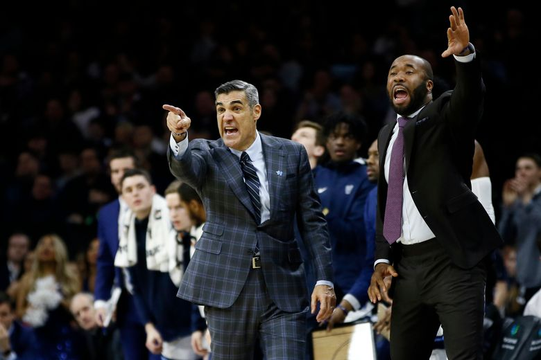 FILE – Villanova head coach Jay Wright, left, and assistant coach Kyle Neptune yell to their team during the second half of an NCAA college basketball game against Creighton in Philadelphia, in this Saturday, Feb. 1, 2020, file photo. Fordham hired longtime Villanova assistant Kyle Neptune on Tuesday, March 30, 3021, to take over a men's basketball program that has had only two winning seasons since joining the Atlantic 10 Conference in 1995. (AP Photo/Matt Slocum, File)