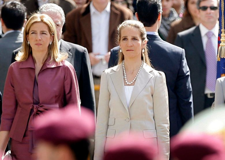 """FILE – In this Wednesdday, April 16, 2008 file photo, Spain's Princess Cristina, left and Princess Elena, listen to the Spanish national anthem during a ceremony, upon their arrival for the opening of the Spanish Parliament, after Jose Luis Rodriguez Zapatero's Socialist Party won the general elections on March 9, in Madrid. The sisters of Spanish King Felipe VI have acknowledged on Wednesday, March 3, 2021, that they were administered COVID-19 vaccines during a visit to the United Arab Emirates. In a statement published by a Spanish newspaper, the Infantas Elena and Cristina said that they were """"offered the possibility"""" of receiving vaccines while in Abu Dhabi to visit their father and former monarch, Juan Carlos I.  (AP Photo/Daniel Ochoa de Olza, File)"""