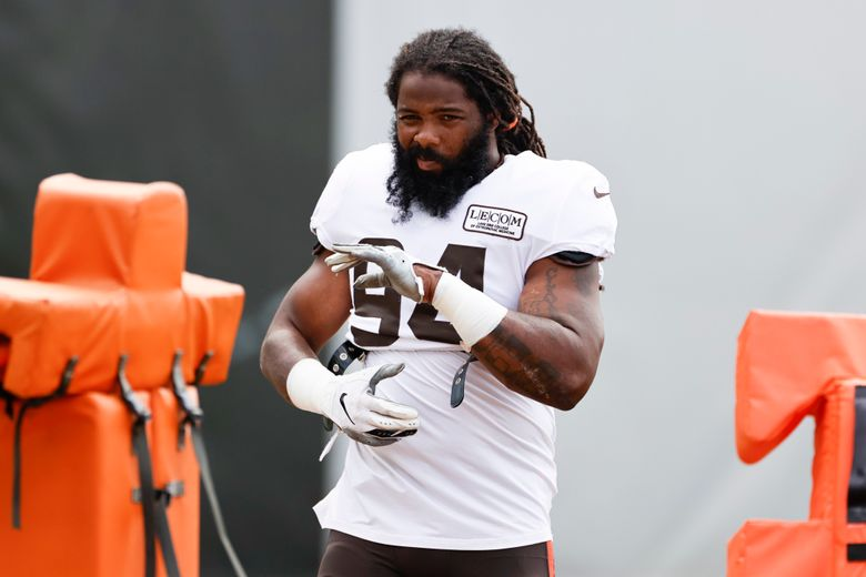 FILE – Cleveland Browns defensive end Adrian Clayborn warms up during practice at the NFL football team's training facility Monday, Aug. 24, 2020, in Berea, Ohio. The Browns cleared out a little more salary-cap space on Tuesday, March 9, 2021 by releasing veteran defensive end Adrian Clayborn after one season. (AP Photo/Ron Schwane)