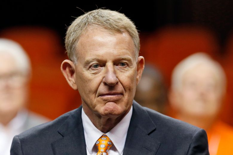 FILE – In this March 23, 2016, file photo, Oklahoma State athletic director Mike Holder watches during a news conference to introduce Brad Underwood as the new Oklahoma State NCAA college basketball coach in Stillwater, Okla. Holder will step down after 16 years and Chad Weiberg will replace him. The school says the moves will be effective July 1. Holder took over in 2005.  (AP Photo/Sue Ogrocki, File_