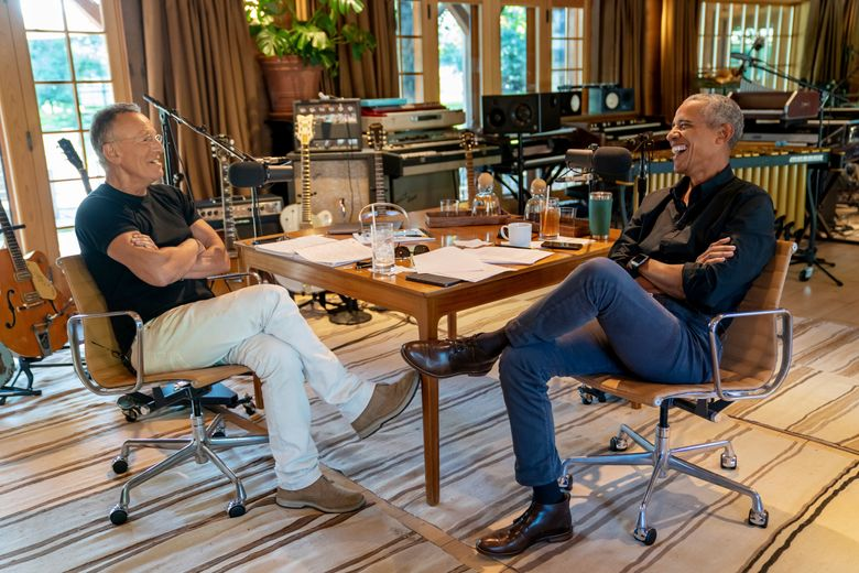 Bruce Springsteen, left, appears with  former President Barack Obama during their podcast of conversations recorded at Springsteen's home studio in New Jersey. The eight-episode series covers their upbringings, racism, fatherhood and even recall a White House singalong around a piano. (Rob DeMartin/Spotify via AP)