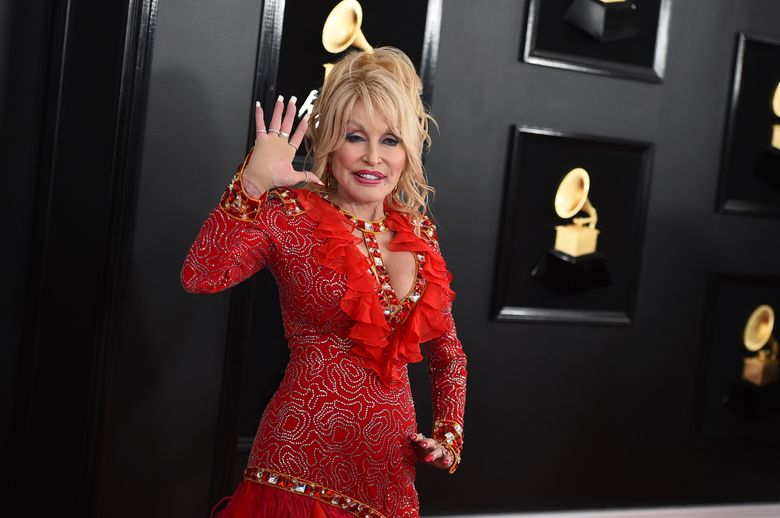 Dolly Parton in 2019 in Los Angeles. The Grammy-winning singer, actor and humanitarian posted a video on Tuesday of her singing just before getting her COVID-19 vaccine shot. Parton donated $1 million to Vanderbilt University Medical Center in Nashville, Tennessee for coronavirus research. (Photo by Jordan Strauss/Invision/AP, file)