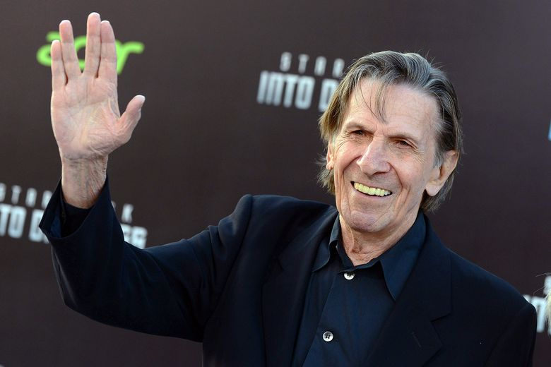 """FILE – In this May 14, 2013 file photo, Leonard Nimoy gives a """"Live Long and Prosper"""" hand gesture arrives at the LA premiere of """"Star Trek Into Darkness"""" in Los Angeles. The Museum of Science, Boston, in collaboration with the Nimoy's family announced the development of a monument shaped in the hand gesture made famous by the actor's character, Mister Spock, to honor the Boston native who died in 2015. (Photo by Jordan Strauss/Invision/AP, File)"""