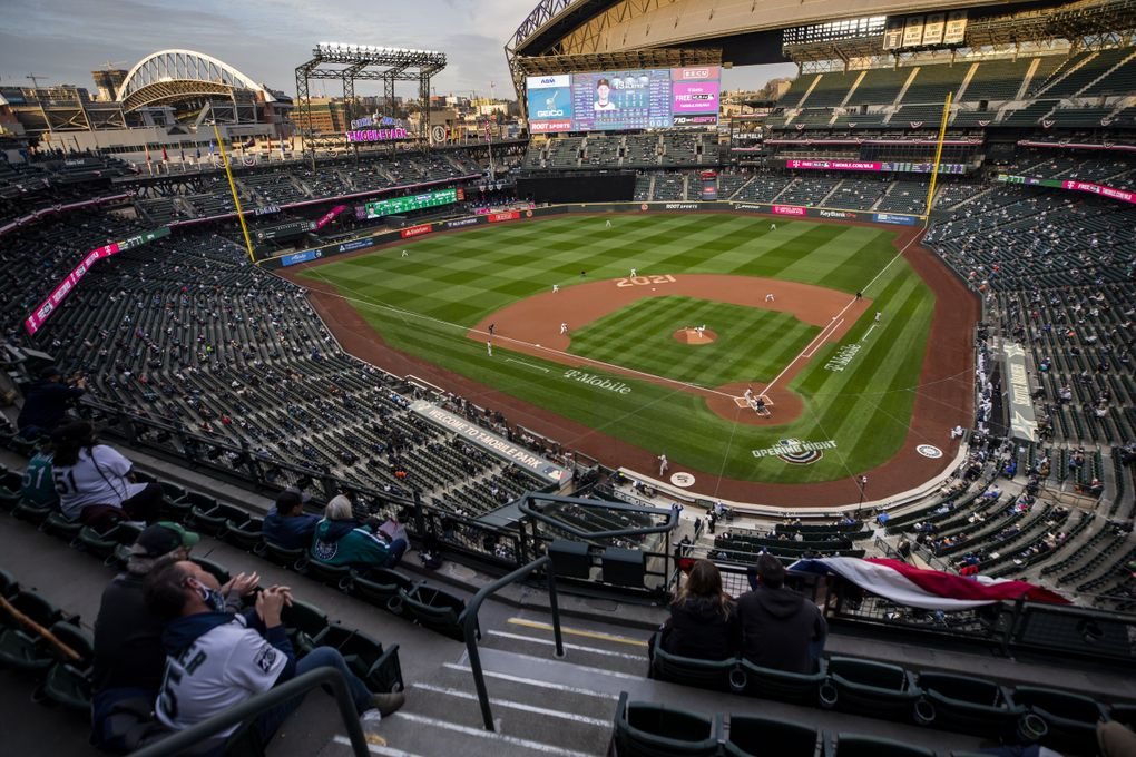 Mariners starting pitcher Marco Gonzales throws the first pitch as the Seattle Mariners take on the San Francisco Giants for their home opener at T-Mobile Park in Seattle on Thursday, April 1, 2021. (Bettina Hansen / The Seattle Times)