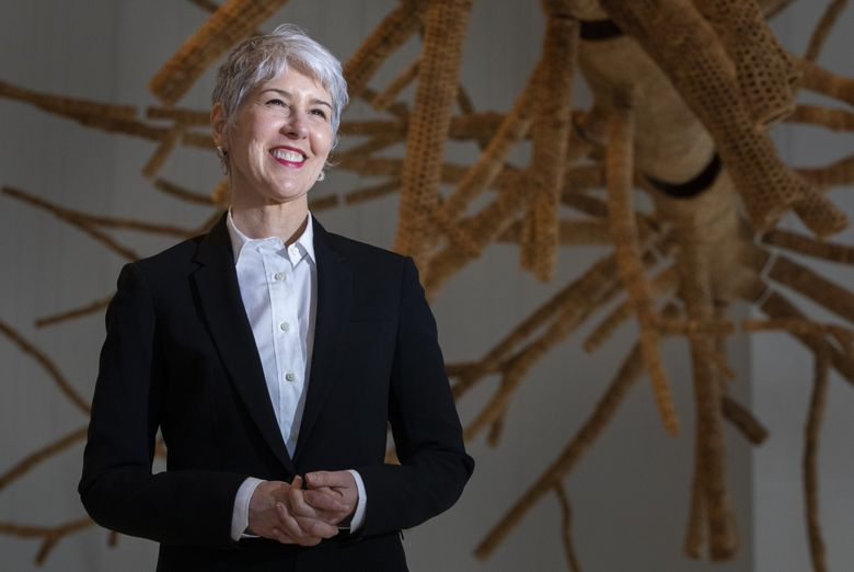 """Amada Cruz, director and CEO of the Seattle Art Museum, stands in front of """"Middle Fork,"""" a sculpture by John Grade. For Cruz, dealing with the unknown presented one of the biggest challenges of running an institution like SAM during a massive public health crisis. (Ellen M. Banner / The Seattle Times)"""