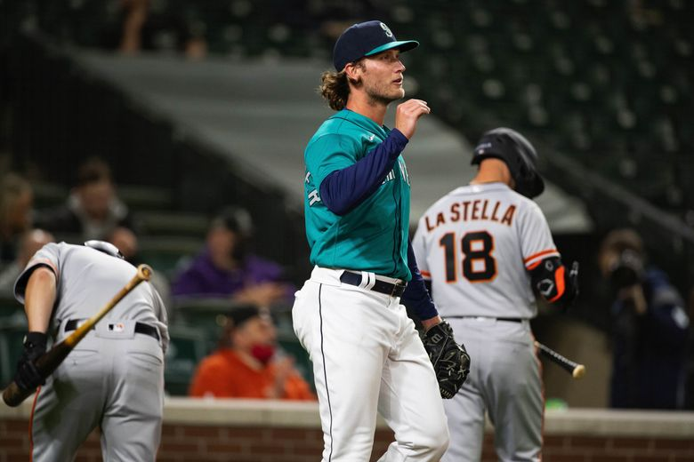 Drew Steckenrider heads back to the mound having given up his third run of the 7th inning against the San Francisco Giants on April 2, 2021 at T-Mobile Park. (Dean Rutz / The Seattle Times)