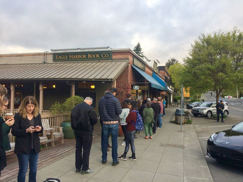 Book lovers line up outside Eagle Harbor Book Co. on Bainbridge Island on Seattle Independent Bookstore Day in 2019. Things will likely look somewhat different during this year's Seattle Independent Bookstore Day. (Moira Macdonald / The Seattle Times)
