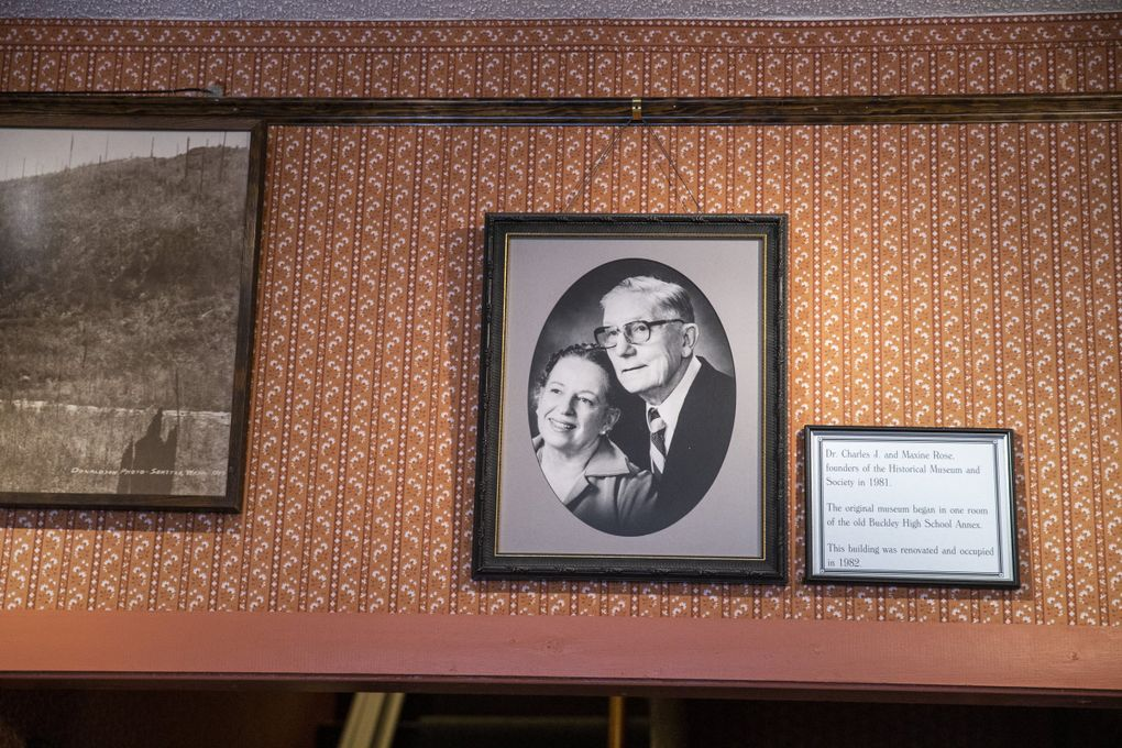 A photo of Dr. Charles J. and Maxine Rose, founders of the Historical Museum and Society in 1981, hangs on the wall as you walk into the Foothills Historical Museum in Buckley, Washington. The original museum ran out of an annex at White River High School before it moved in 1982.  (Amanda Snyder / The Seattle Times)
