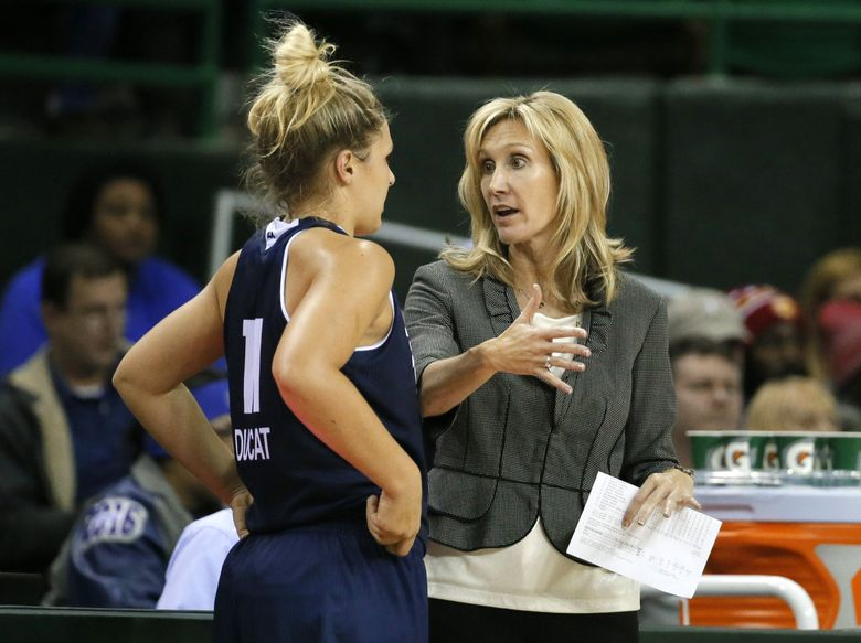 Rice's head coach Tina Langley talks with Lexie Ducat (11) during a game in 2015. (Tony Gutierrez / AP, file)