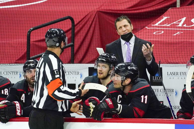 Carolina Hurricanes coach Rod Brind'Amour speaks with an official during a game against the Columbus Blue Jackets in Raleigh, N.C., March 18, 2021. (Gerry Broome / AP)