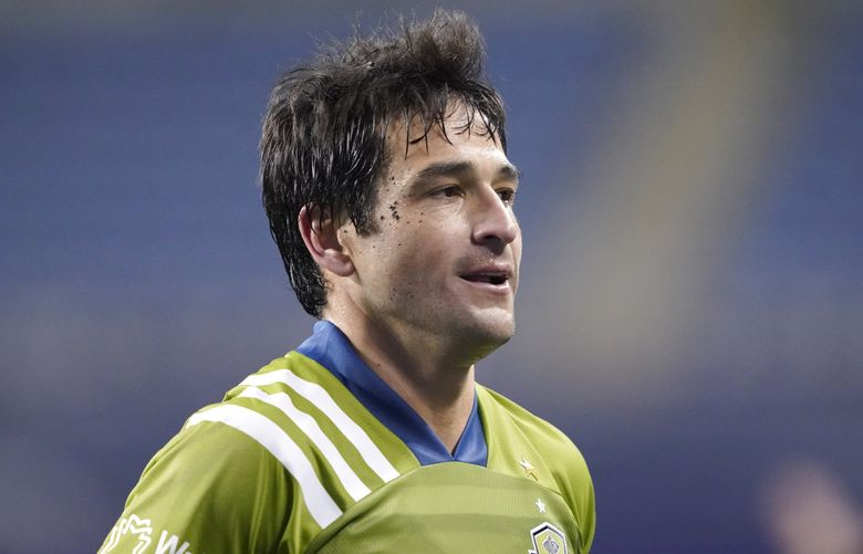 Seattle Sounders midfielder Nicolas Lodeiro runs off the field after the team beat FC Dallas in an MLS playoff soccer match, Tuesday, Dec. 1, 2020, in Seattle. (AP Photo/Ted S. Warren) (Ted S. Warren / AP)