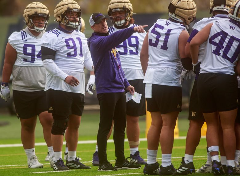 Defensive coordinator Bob Gregory talks with players at UW Huskies spring practice at the east practice field on Friday, April 9, 2021.  (Erika Schultz / The Seattle Times)