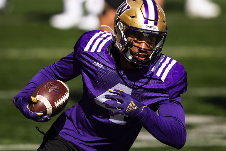 Wide receiver Terrell Bynum makes a catch as the University of Washington Huskies participate in their spring practice at Husky Stadium Saturday April 10, 2021 in Seattle. (Bettina Hansen / The Seattle Times)