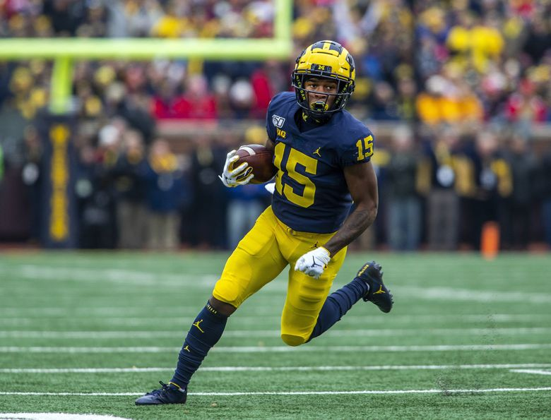 Michigan wide receiver Giles Jackson rushes for a 22-yard touchdown against Ohio State in Ann Arbor, Mich., Nov. 30, 2019. (Tony Ding / AP)