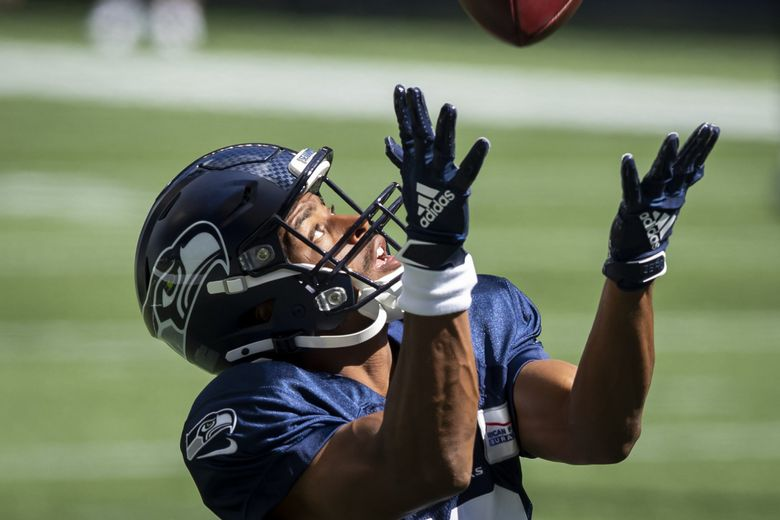 Seahawks wide receiver Tyler Lockett catches an over-the shoulder pass during warmups as the Seattle Seahawks hold a mock game at CenturyLink Field in Seattle Saturday, Aug. 22, 2020. (Bettina Hansen / The Seattle Times)