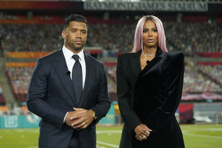 Seattle Seahawks quarterback Russell Wilson and his wife Ciara talk make a statement after Wilson won the Walter Payton NFL Man of the Year awards at the NFL Honors ceremony as part of Super Bowl 55 Friday, Feb. 5, 2021, in Tampa, Fla. (Charlie Riedel / AP)