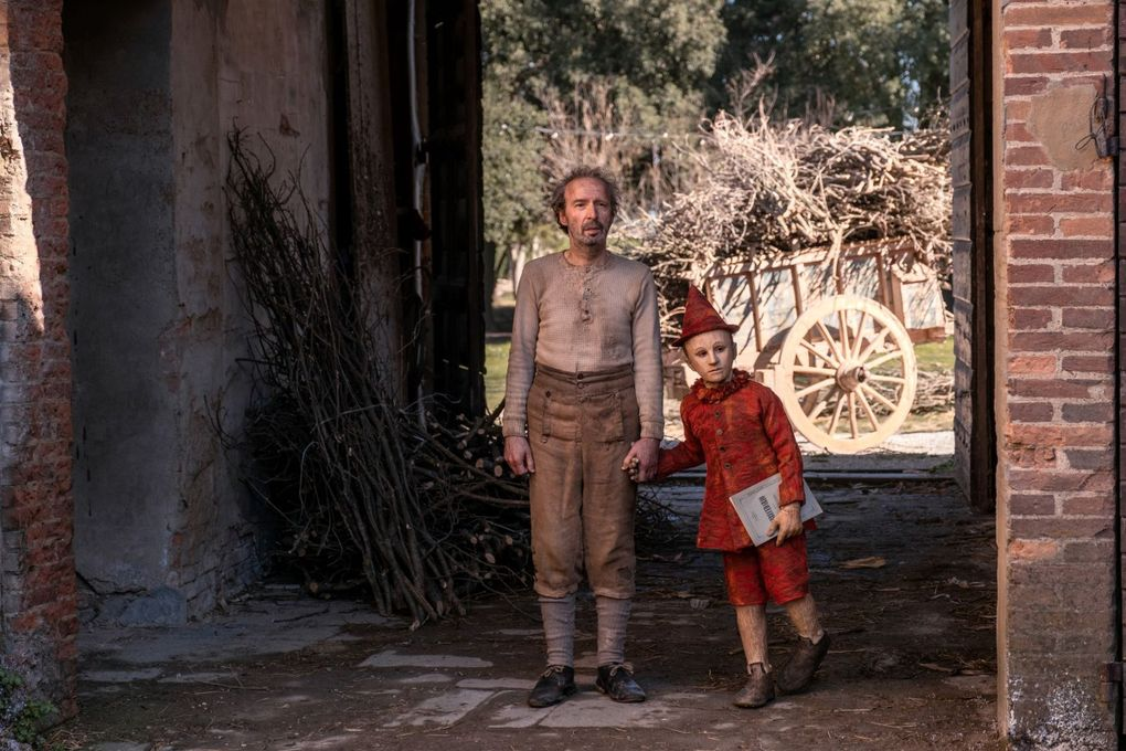 "Roberto Benigni as Geppetto and Federico Ielapi as Pinocchio in ""Pinocchio,"" nominated for an Academy Award for costume design.  (Greta De Lazzaris / Roadside Attractions)"