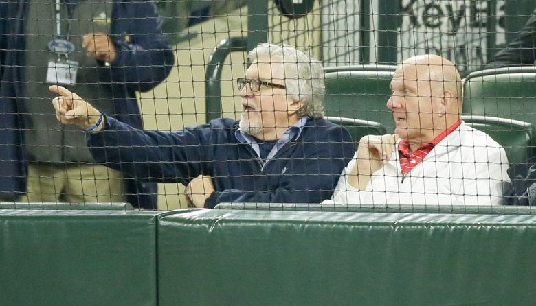 Jeff Raikes, left, sits with Los Angeles Clippers owner and former Microsoft CEO Steve Ballmer at a Seattle Mariners and Los Angeles Angels game in 2016 in Seattle. (Ted S. Warren / AP, file)