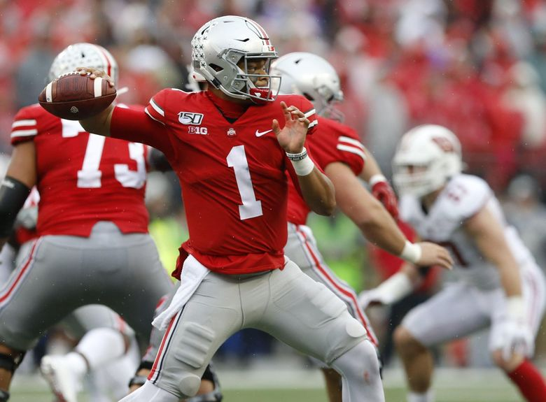 Justin Fields, Ohio State's quarterback, is expected to be a high draft pick. (Adam Cairns/Columbus Dispatch) (ADAM CAIRNS/COLUMBUS DISPATCH / TNS)