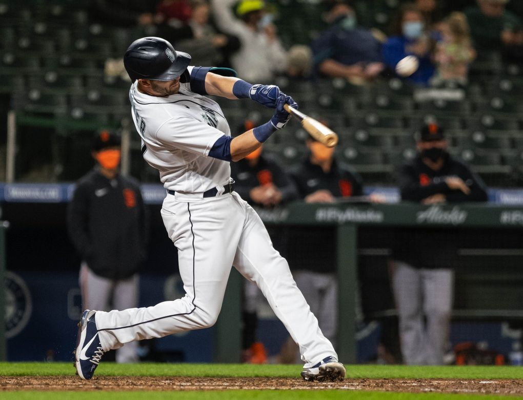 Mitch Haniger sends a solo home run to left field against the Giants earlier this month at T-Mobile Park. (Dean Rutz / The Seattle Times)