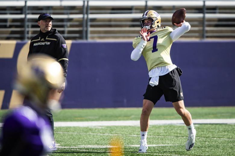 John Donovan, left, offensive coordinator and quarterbacks coach, watches quarterback Sam Huard as the University of Washington Huskies participate in their spring practice at Husky Stadium Saturday April 10, 2021 in Seattle. (Bettina Hansen / The Seattle Times)