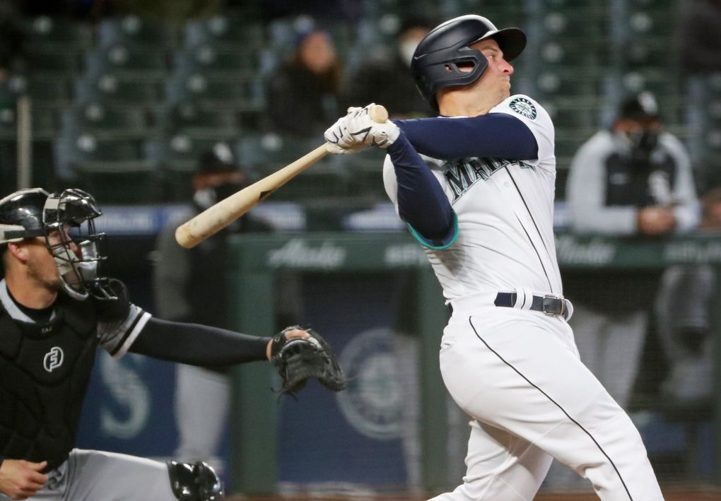 Mariners third baseman Kyle Seager hits a three-run double to put the Mariners back in the lead in the sixth inning against the White Sox on April 7. (Ken Lambert / The Seattle Times)