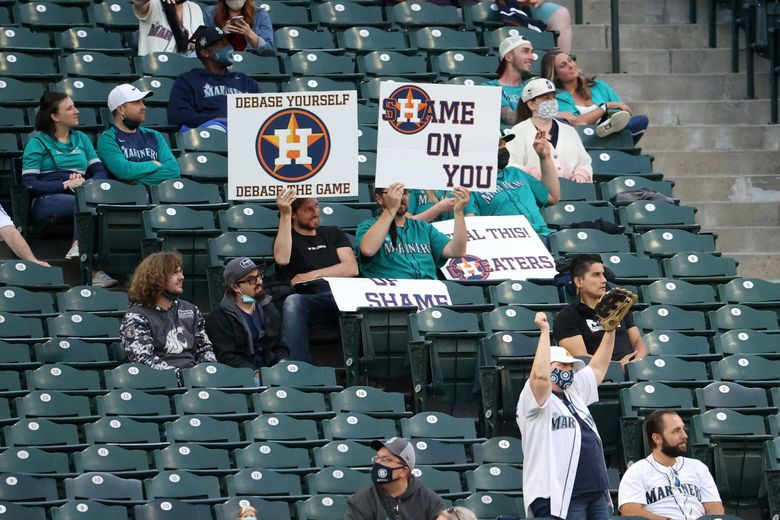Mariners fans heckle the Houston Astros for their sign-stealing scandal during Friday night's game at T-Mobile Park. (Abbie Parr / Getty Images)
