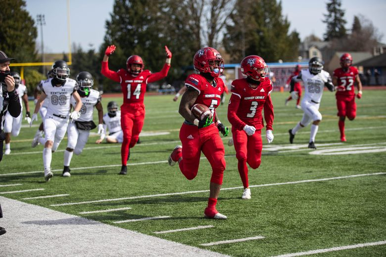 Kennedy Catholic's Leland Ward is off and running returning the kick to inside the Kentwood 10 yard line in the 3rd quarter.  Sam Huard became the state's all-time passing leader with Kennedy's 60-17 win over Kentwood Saturday, March 27, 2021. (Dean Rutz / The Seattle Times)
