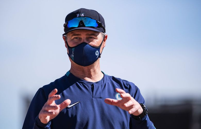 Manager Scott Servais talks to reporters just off the field Tuesday, February 23, 2021 In Peoria, AZ. (Dean Rutz / The Seattle Times)