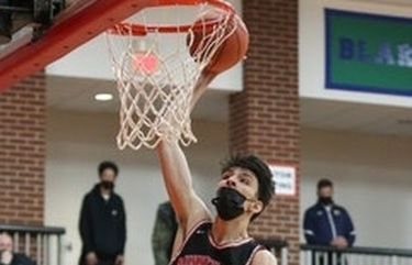 Chet Holmgren, shown here dunking against Totino-Grace in the Class 3A, section 4 championship on Friday, was named the Wootten National Player of the Year in boys' basketball.