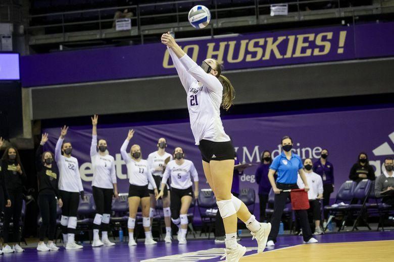 Washington outside hitter Claire Hoffman gets an assist for the winning point of the first set as the Huskies take on the Utah Utes in February. (Bettina Hansen / The Seattle Times)