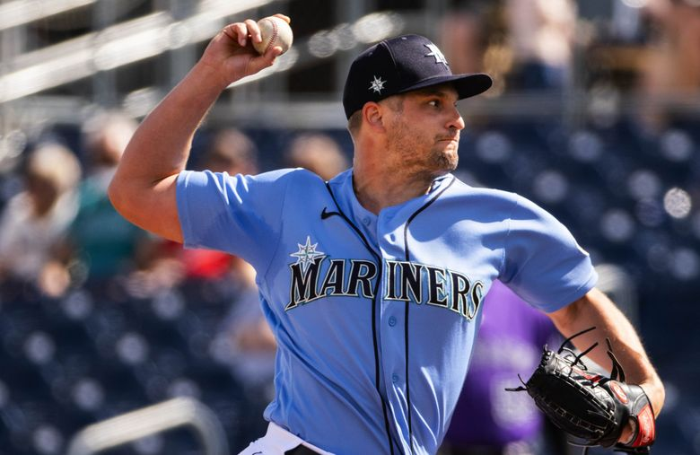 Kendall Graveman pitches against Colorado during a spring game.  The Colorado Rockies and Seattle Mariners played to a 9-9 tie Thursday, March 2, 2021 in Spring Training baseball in Peoria, AZ. 216539 (Dean Rutz / The Seattle Times)