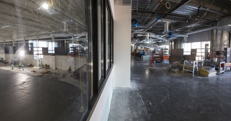 The Kraken Training Center at Northgate Mall is on track to open to the public this fall.  This angle shows where the Kraken Bar and Grill will overlook the Number One rink that is now being covered with cement, Wed. April 14, 2021. (Steve Ringman / The Seattle Times)