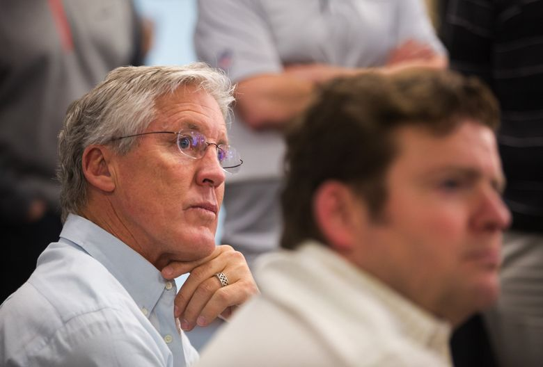 Coach Pete Carroll listens to media questions with general manager John Schneider, right, after the close of the 2016 NFL Draft at the Virginia Mason Athletic Center in Renton. (Lindsey Wasson / The Seattle Times, file)