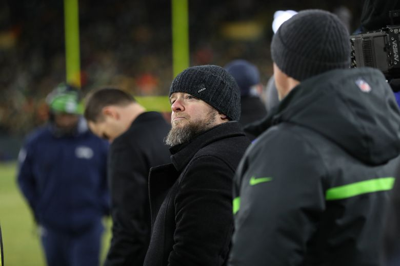 John Schneider watches the Seattle Seahawks play the Green Bay Packers in a NFC Divisional playoff game at Lambeau Field in Green Bay, Wisconsin, Jan. 12, 2020. (Dean Rutz / The Seattle Times)