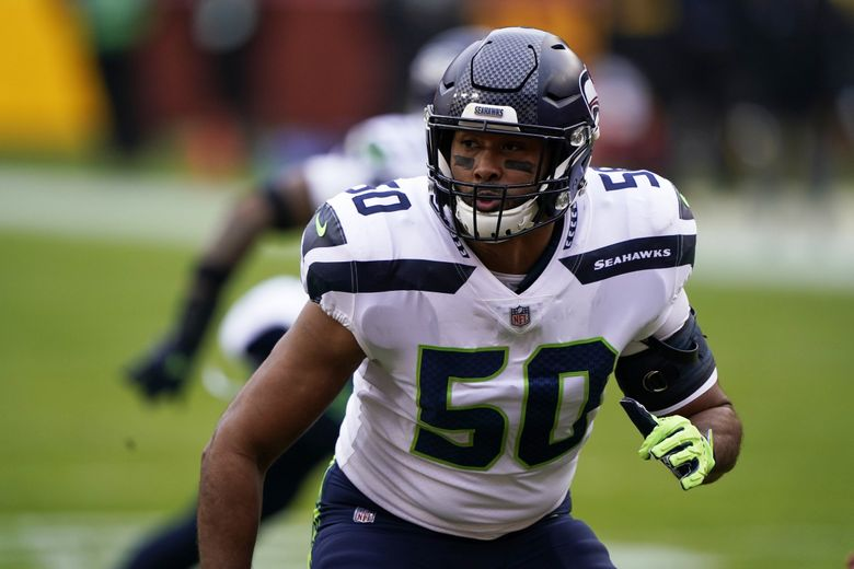 Seattle Seahawks outside linebacker K.J. Wright rushes the line of scrimmage during a game against the Washington Football Team last December. (Mark Tenally / The Associated Press)