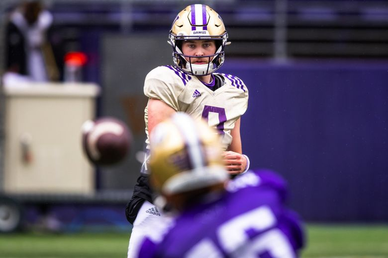 Huskies quarterback Dylan Morris throws to wide receiver Rome Odunze during spring practice with the University of Washington football team at Husky Stadium Saturday April 24, 2021. (Bettina Hansen / The Seattle Times)