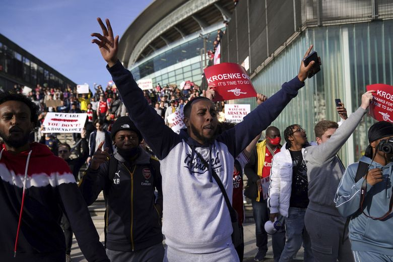 Soccer fans protest against Arsenal owner Stan Kroenke before their English Premier League match against Everton, at the Emirates Stadium in London on Friday. The fans want owner Stan Kroenke to leave the club over its bid to join the failed Super League.  (John Walton/PA via AP)