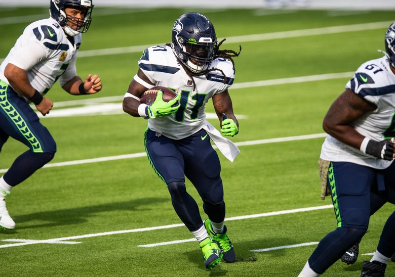 Seattle Seahawks running back Alex Collins rushes for a touchdown during the first half of the NFL game between the Seattle Seahawks and the Los Angeles Rams at Sofi Stadium in Los Angeles, CA on Nov. 15, 2020. (Andy Bao / The Seattle Times)